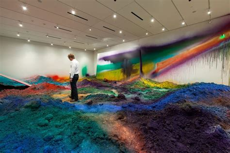 colorful mountains of spray-painted soil by katharina grosse